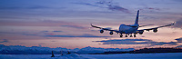 China Air cargo jet lands one minute after sunset at 3:42 PM on winter soltice, December 21, 2011, Ted Stevens International Airport, Anchorage.