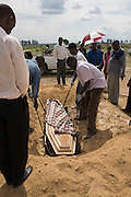 Relatives and friends grieve for another victim of the Cholera outbreak in Zimbabwe...The funeral of Emmely Munyongo who died, aged 74 years, from Cholera at her home in the suburb of Glenora on the outskirts of Harare, Zimbabwe.....