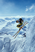 American extreme skier Scott Schmidt jumps in while making a first descent in the Chugach Mountains, near Valdez Alaska.