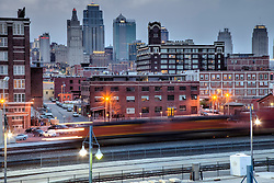 Kansas City skyline at dusk with train motion in foreground, taken from top of the parking garage at Union Station looking northward.