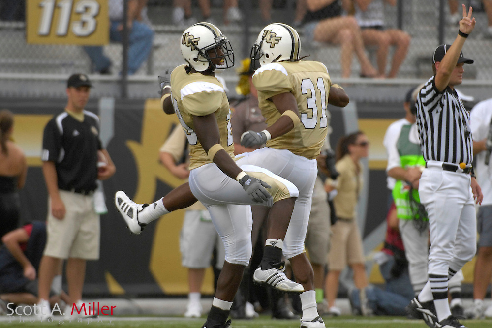 Sep 15, 2007; Orlando, FL, USA; Central Florida  Knights defenders (29) Sha'reff Rashad and (31) Johnell Neal celebrate a play against the Texas Longhorns during the first quarter in Bright House Stadium. ...©2007 Scott A. Miller