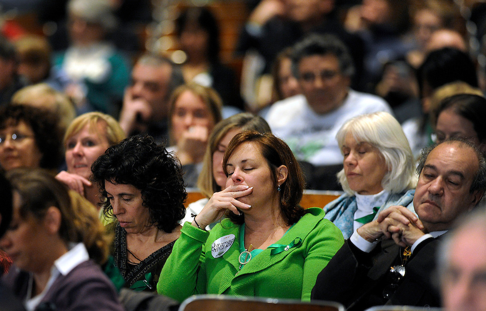 Residents of Newtown, Conn. fill an auditorium and listen during a hearing of a legislative task force on gun violence and children's safety at Newtown High School in Newtown, Conn., Wednesday, Jan. 30, 2013. Connecticut lawmakers are in Newtown for the hearing, where those invited to give testimony include first responders and families with children enrolled at Sandy Hook Elementary. (AP Photo/Jessica Hill)