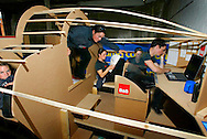 Computer manipulated photo of yactswoman Ellen MacArthur sitting in a mocked-up version of the cramped living space aboard her 75ft solo triamaran in Cowes, Isle of Wight, before it is constructed.