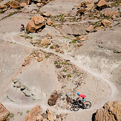 Racers drop into Andy's Loop during the Grand Junction Off-Road. <br /> Photos by Brian Leddy