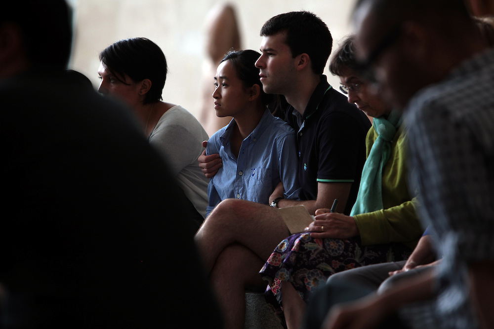 Members of the audience listen to Remembering September 11, Wordless Music Orchestra conducted by Ryan McAdams presented at The Temple of Dendur in The Sackler Wing at The Metropolitan Museum of Art in Manhattan, NY on September 11, 2011...
