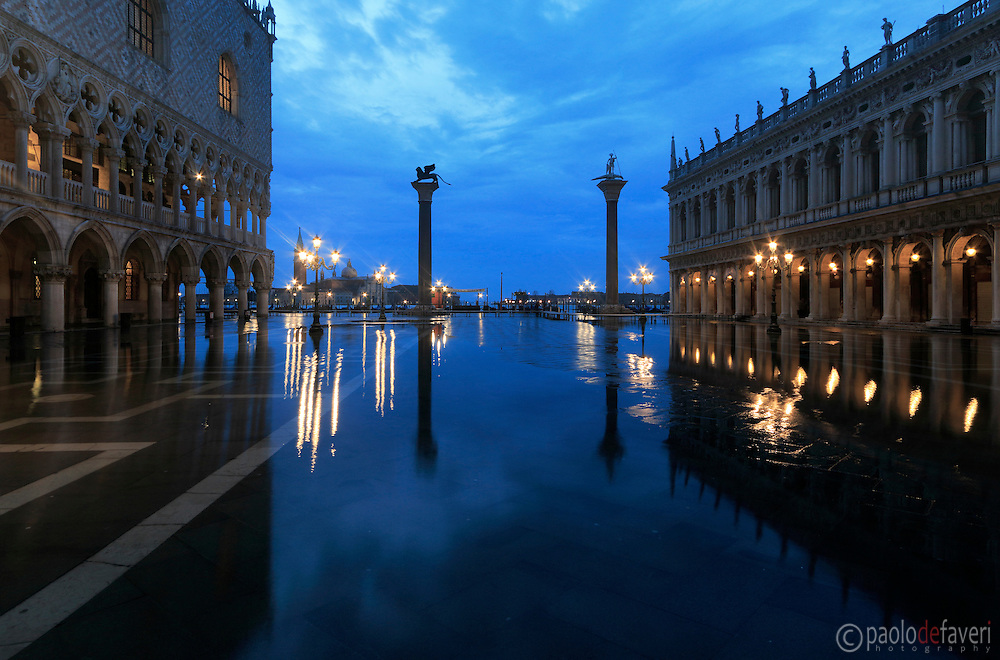 "Piazzetta San Marco at sunrise, with the Doge's Palace and the Marciana Libray. Taken on a early morning at the end of January, while the  rising tide was starting to flood the square, producing that phenomenon known as ""acqua alta""."