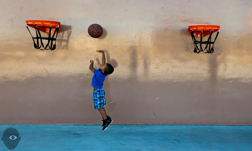 Akene Anyanwu, 3, practices his shot on the basketball court at Mountain's Edge Regional Park.