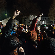 Protestors with the Black Lives Matter movement protest started to try to surround the Minneapolis Police Department 4th precinct headquarters after dark fell, during this newest round of protests which erupted after activists who had been camped out in the front entrance to the precinct were cleared out on Wednesday, November 18, 2015 in Minneapolis, Minnesota. <br /> <br /> Protests and the encampment came in reaction to the shooting of 24-year-old Jamar Clark by Minneapolis Police on Sunday. <br /> <br /> <br /> Photo by Angela Jimenez for Minnesota Public Radio www.angelajimenezphotography.com