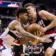 WASHINGTON, USA - January 16: Portland Trail Blazer Meyers Leonard (11) and Washington Wizard Kelly Oubre (12) struggle over the ball at the Verizon Center in Washington, USA on January 16, 2017. The Wizards defeated the Blazers 120-101.