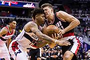 WASHINGTON, USA - January 16: Portland Trail Blazer Meyers Leonard (11) and Washington Wizard Kelly Oubre (12) struggle over the ball at the Verizon Center in Washington, USA on January 16, 2017. The Wizards defeated the Blazers 120-101.