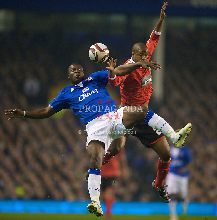 LIVERPOOL, ENGLAND - Thursday, November 5, 2009: Everton's Joseph Yobo and SL Benfica's Sidnei during the UEFA Europa League Group Stage match at Goodison Park. (Photo by David Rawcliffe/Propaganda)