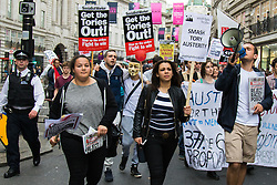 London, May 27th 2015. Protesters march along Regent Street as they demonstrate against the Tories' ongoing campaign of austerity on the day the Queen delivered her speech to Parliament