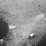 A man and a car in the Jialing river, the jialing river joins the yangtze river in Chongqing.