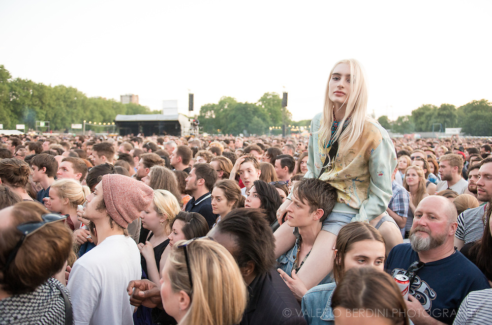A girl has a privileged view of the main stage. Field Day festival in London Victoria Park on 8 June 2014
