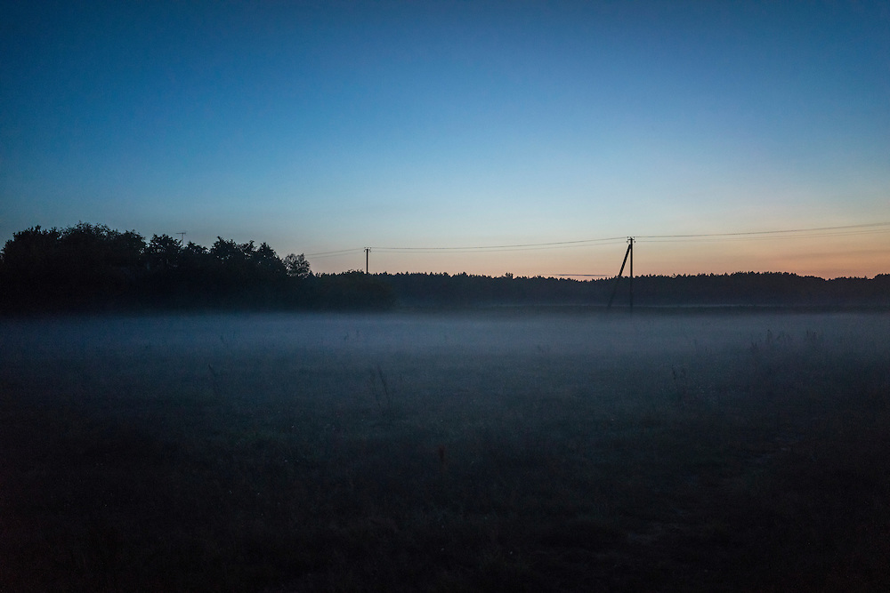 Fog settles at dusk on Friday, September 16, 2016 in Falkavicy, Belarus.