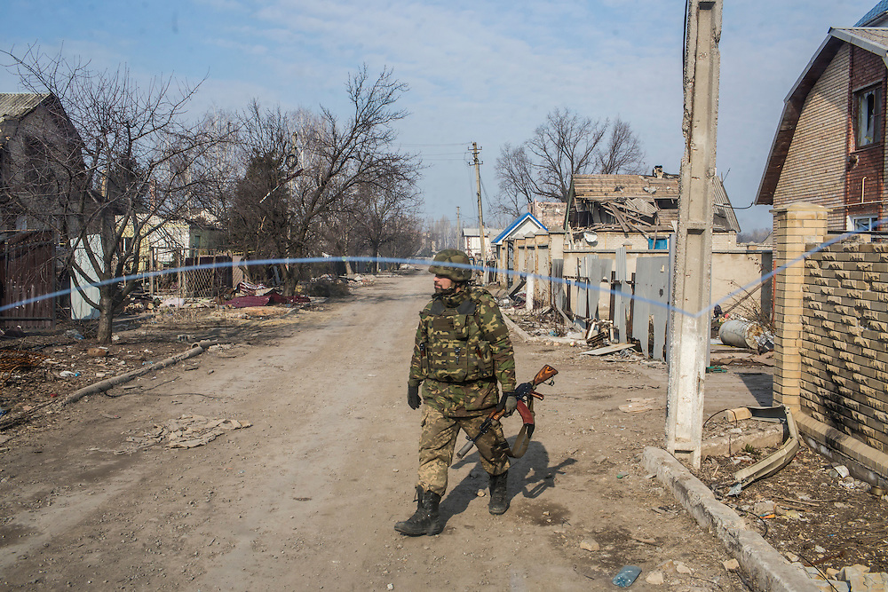 PISKY, UKRAINE - MARCH 20, 2015: Volodya, a fighter for the Dnipro-1 battalion, a pro-Ukrainian militia, is seen through a broken windshield in the heavily contested town of Pisky, Ukraine. CREDIT: Brendan Hoffman for The New York Times