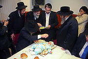 Pidyon Haben is a rite of passage in Judaism that is known as 'the redemption of the first born son'. It takes place when a baby is at least 31 days old, and involves 'buying him back from a Cohen.' Here the baby is draped in gold by the mother, grandmother and family and then bought back from a Cohen for 5 pieces of silver. Each man attending takes some of the sugar cubes as a part of the ceremony. The baby has to be the first boy who has opened his mother's womb and not have been delivered by a caesarean birth.