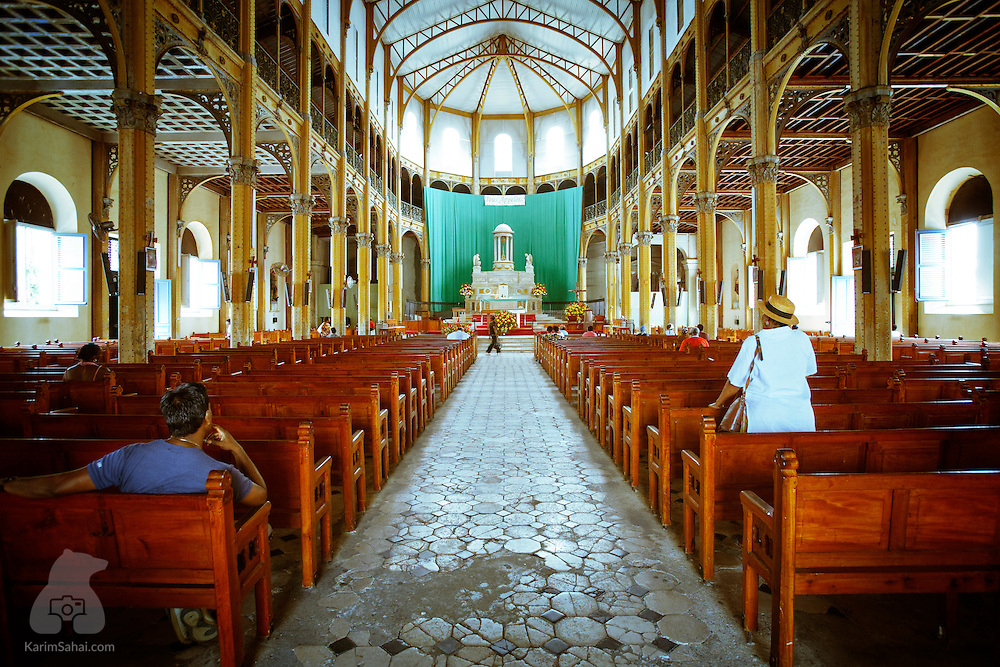 Worshipers pray inside the St Pierre & St Paul cathedral, Pointe-A-Pitre, Guadeloupe.