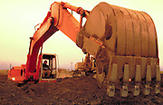 Alaska. Bucket of a large Hitachi excavator working on a construction site.