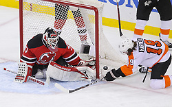 May 6, 2012; Newark, NJ, USA; New Jersey Devils goalie Martin Brodeur (30) makes a save on Philadelphia Flyers left wing Scott Hartnell (19) during the third period in game four of the 2012 Eastern Conference semifinals at the Prudential Center.  The Devils defeated the Flyers 4-2.