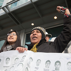 FRIDAY, MARCH 26, 2015 - Washington University student Isabel Gloria (left) and Maria De La Cruz, joined other supporters of 43 students who disappeared in September 2014 from the Raúl Isidro Burgos Rural Teachers' College of Ayotzinapa in Iguala, Guerrero, Mexico, as they marched Friday through downtown St. Louis. Some in the group are making their way across the United States to spread their message that the Mexican government is ignoring their demands for justice, transparency and accountability. Maria De La Cruz's son, Jesus Tlamtepa, was apparently one of the students who disappeared. NOTE: THE SPELLING OF THE MARIA DE LA CRUZ IS QUESTIONABLE DUE TO LANGUAGE DIFFERENCES ©Photo by Jerry Naunheim Jr.