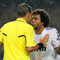 Real Madrid's Marcelo Vieira (r) have words with the referee Frank De Bleeckere during UEFA Champions League match.May 3,2011.