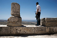 Syria. A member of the Free Syrian Army stands in the archeological site of Qal'at Sama'an, few kilometers from the village of Dar Ta'Zah.  ALESSIO ROMENZI