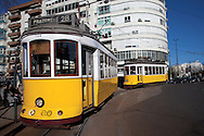 Two Lisbon's nº28 yellow trams arrive at Prazeres station, finishing his trip through the central, most historic region of the city.