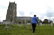 All Saint's Church in Bightlingsea, Essex, UK, and the cemetery which the church says is full and cannot take any more burials. Photograph shows Lyn Mathams whose whole family is buried there..Photo©Steve Forrest/Workers' Photos.