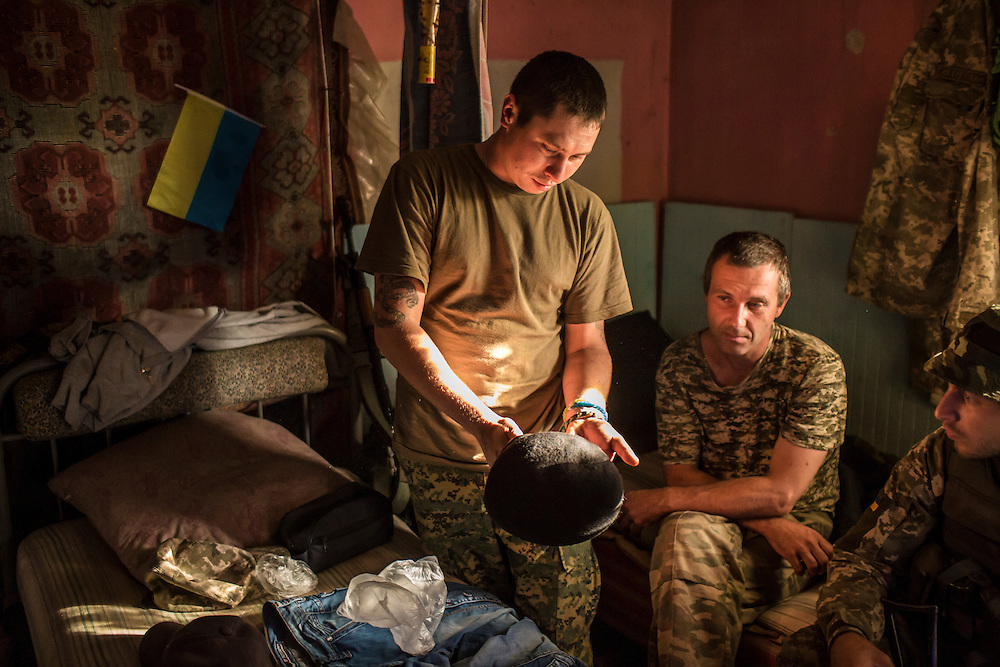 AVDIIVKA, UKRAINE - JULY 9, 2016: Sgt. Ruslan Pilipenko and other soldiers with the 58th brigade in a house they use for sleeping and eating near the front lines in Avdiivka, Ukraine. The town is now one of the most active areas of fighting along the line of control between the Ukrainian government and Russian-backed rebels. CREDIT: Brendan Hoffman for The New York Times