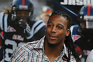 Former Ole Miss player Dexter McCluster speaks during Grove Bowl pre-game activities in the Grove at the University of Mississippi in Oxford, Miss. on Saturday, April 17, 2010.