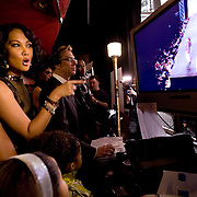 Kimora Lee Simmons and her daughters Aoki and Ming Lee watch a monitor backstage during the Baby Phat fashion show in NYC, 2/1/08.