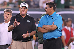 Aug 26, 2012; East Rutherford, NJ, USA; New York Jets head coach Rex Ryan and Carolina Panthers head coach Ron Rivera talk during warmups at MetLife Stadium.