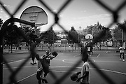 Kids play basketball at the playground on Kosciuzko Street and Broadway in Bushwick, NY on Friday, June 24, 2016.