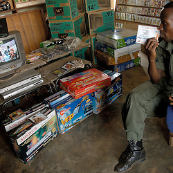 A VIDEOCLUB, FULL OF FORGED VCDS AND VIDEOS / MARS 2006, NATITINGOU, BENIN / ANTOINE DOYEN