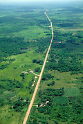 Deforestation: aerial of road going through former rainforest cleared for agriculture and cattle raising, Amazon rainforest, Para State, Brazil