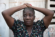 A woman in the Cité-de-Dieu neighborhood weeps as UN and Haitian security forces arrest her son, an  operation criticized by human rights organizations as illegal. Port-au-Prince, Haiti, February 1, 2008.
