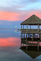 Calm reflection of a gazebo on Currituck sound at Corolla on the Outer Banks.