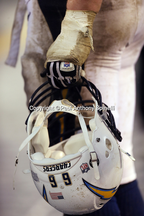 San Diego Chargers tackle Jeromey Clary (66) holds his helmet with a muddied and ripped taped hand during the NFL week 17 football game against the Oakland Raiders on Sunday, Dec. 30, 2012 in San Diego. The Chargers won the game 24-21. ©Paul Anthony Spinelli
