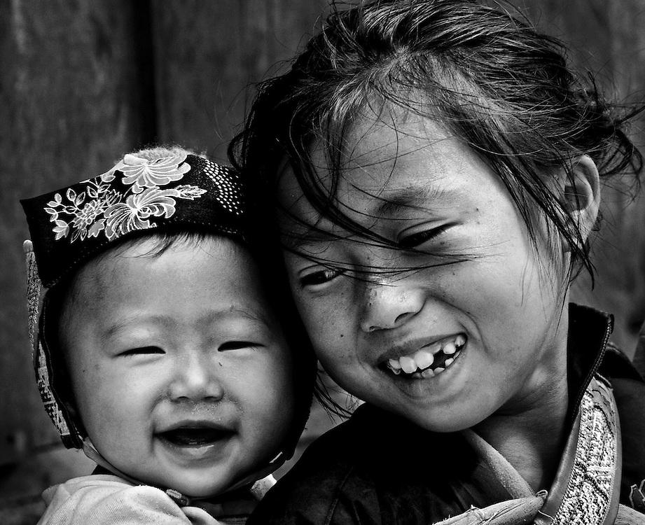 Hmong children in a village outside of Luang Prabang, Laos.