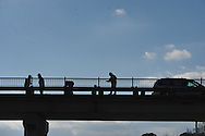 Workers install a metal railing atop the bridge on South Lamar where it crosses Highway 6, in Oxford, Miss. on Monday, March 11, 2013.