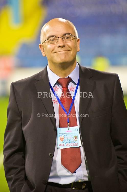 PODGORICA, MONTENEGRO - Wednesday, August 12, 2009: Wales' press officer Ceri Stennett during an international friendly match at the Gradski Stadion. (Photo by David Rawcliffe/Propaganda)