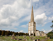 "The most identifiable landmark in the village of Painswick is the parish church of St. Mary's dating to the early Norman period. The churchyard's clipped yew trees are another feature of the town...Evidence suggests that the church was built between 1042 and 1066. Looking closely at the tower, you'll see the scars of cannonballs left by a bombardment during the Civil War. Parliamentary troops took refuge in the church, but they were forced out by a combination of cannon fire and burning torches wielded by Royalist soldiers...Passing through the half-timbered lych-gate -- a roofed entry to the churchyard -- is the graveyard, the final resting place of rich wool merchants and the yew trees that draw the most attention. The church is also open for tour...There are two legends surrounding the yews. One legend says that the trees are uncountable, the other, that there are 99 trees, and if a hundredth was to be planted, the devil would pull it out...Every year, on the nearest Sunday to September 19, the ""clipping the church"" takes place. Local children wear flowers in their hair, join hands and embrace the church."