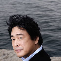 """Park Chan Wook presenting his movie """"Thirst"""" (Bakjwi) at the Cannes Film Festival. France. May 2009. Photo: Antoine Doyen"""