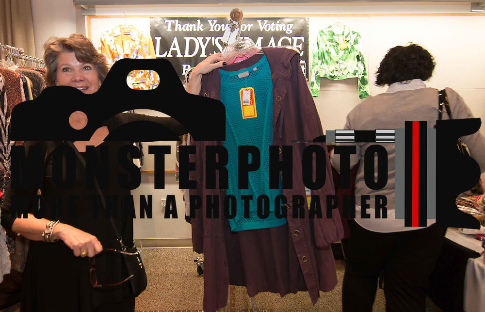 Lady's Images Co-owner Jane Strobel (LEFT) pose for a photo in front of her booth during the 3rd Annual Guilty Girls Warehouse Sale Friday, Feb. 06, 2015 at University of Delaware's Arsht Hall in Wilmington, DE.