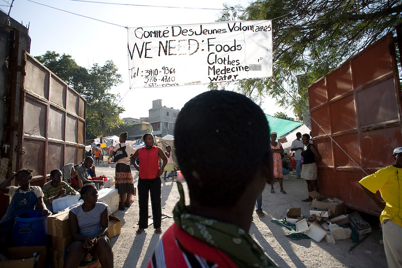 An IDP camp puts up a sign across their entrance requsting help. Delmas, Port Au Prince,  Haiti. 1/19/2010 Photo by Ben Depp.