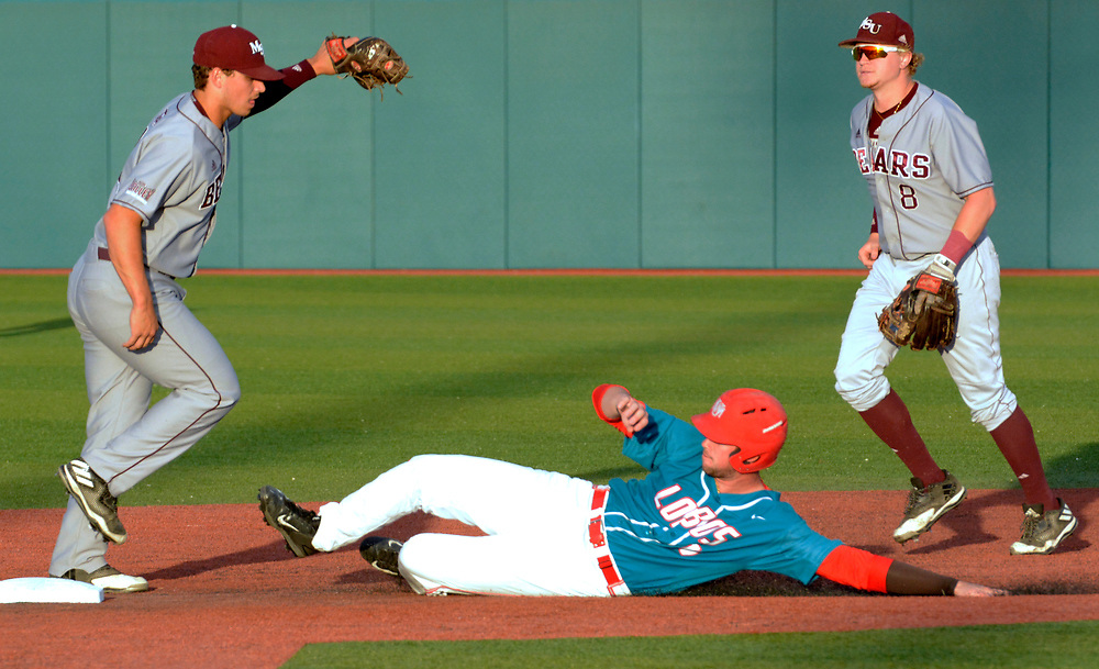 gbs041317f/SPORTS --  UNM's Andrew Pratt is the last out in the first inning as Missouri State's Jeremy Eierman tags the bass and teammate Aaron Meyer, 8, watches at the Santa Ana Star Field on Thursday, April 13, 2017. (Greg Sorber/Albuquerque Journal)