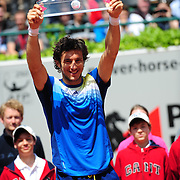 Juan Monaco holding the trophy after winning the final at the Power Horse Cup 2013 at Rochusclub in Duesseldorf, Germany on May 25, 2013. Photo: Miroslav Dakov