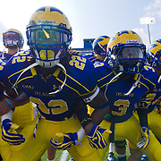 Delaware Linebacker Leon Jackson (22), Delaware Cornerback Tim Breaker (3) and the rest of their teammates get fired up prior to a Week 2 NCAA football game against Delaware State.