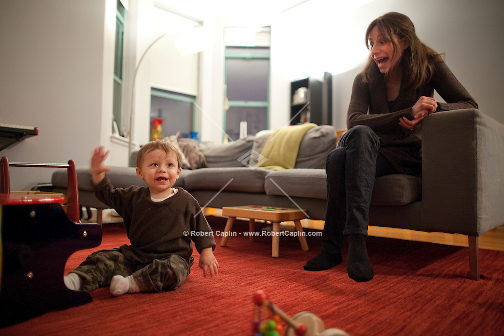 Michael Moshan, Shana Liebman and their son Nate live in a condo in Williamsburg, Brooklyn. Lots of families are discovering that Williamsburg is much more than just a playground for the post-college, skinny jeans set. The neighborhood has two private preschools, several indoor play spaces, art, movement and music classes and multiple kids stores. Many of the new condo buildings rising all over the neighborhood feature play rooms, pools and other family-friendly amenities. ..Photo by Robert Caplin..